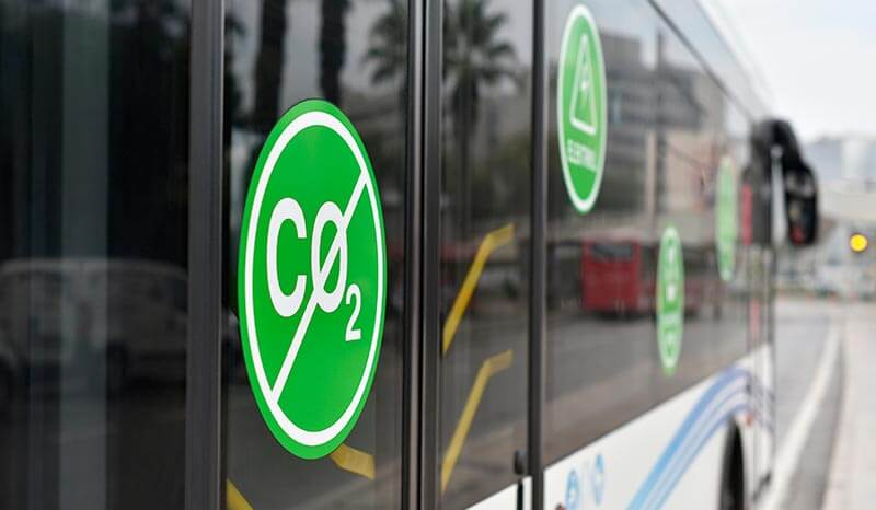 City electric bus. Selective focus on sign: without Carbon dioxide CO2